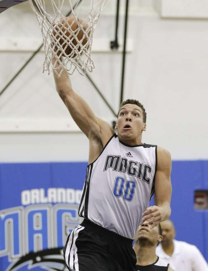 Orlando Magic's Aaron Gordon makes a shot against the Rockets. Photo: John Raoux, Associated Press
