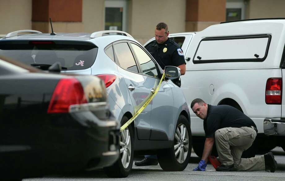 Texas leads most of the nation in the number of children who die in hot cars, a new study published by San Francisco State University says. The Kerr County children were the fourth and fifth children to die after being left in a hot car in Texas this year and the 10th and the 11th in the United States. In this Wednesday, June 18, 2014 file photo Cobb County police investigate an SUV where a toddler died near Marietta, Ga., when the father forgot to drop his child off at day care and went to work. (AP Photo/Atlanta Journal Constitution, Ben Gray, file) GWINNETT OUT  MARIETTA OUT  LOCAL TELEVISION OUT (WXIA, WGCL, FOX 5) Photo: Ben Gray, Associated Press / Atlanta Journal-Constitution