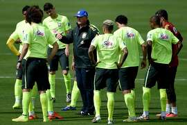 TERESOPOLIS, BRAZIL - JULY 07:  Head coach Luiz Felipe Scolari (C) speaks with his players  during a training session of the Brazilian national football team at the squad's Granja Comary training complex, on July 07, 2014 in Teresopolis, 90 km from downtown Rio de Janeiro, Brazil.  (Photo by Buda Mendes/Getty Images)