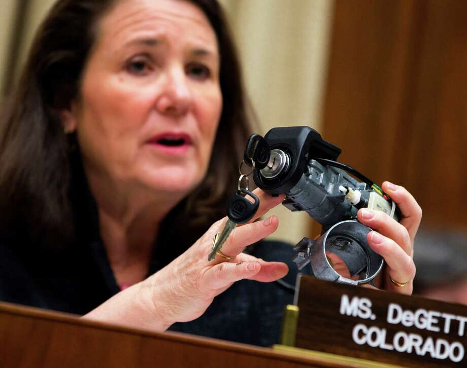 "FILE - In this April 1, 2014 file photo, Rep. Diana DeGette, D-Colo., ranking member of the House Oversight and Investigations subcommittee, holds up a GM ignition switch while she questions General Motors CEO Mary Barra on Capitol Hill in Washington. Responding to complaints about ""cheap-feeling"" switches that required too much effort to turn, General Motors set about making new ones that would work more smoothly and give drivers the impression that they were better designed, a GM switch engineer testified in a lawsuit deposition in the spring of 2013. The switches, though, were too loose, touching off events that led to at least 13 deaths, more than 50 crashes and a raft of legal trouble for the Detroit automaker. (AP Photo/Evan Vucci, File) ORG XMIT: NYBZ138 Photo: Evan Vucci / AP"