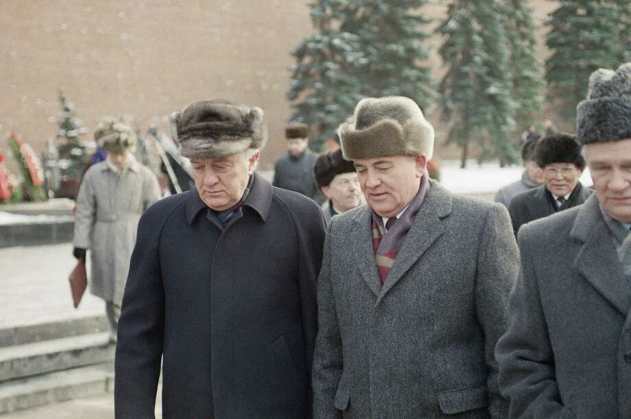 Soviet President Mikhail Gorbachev and Soviet Foreign Minister Eduard Shevardnadze, left, talk to each other on their way to a wreath laying ceremony commemorating the 50th anniversary of the Battle of Moscow in 1991. Shevardnadze, who later became president of an independent Georgia, died Monday at the age of 86. Photo: Boris Yurchenko, STR / AP