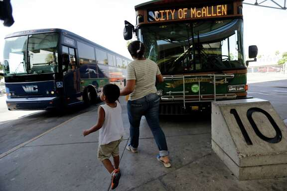 In this June 20, 2014 photo, Cindy Jimenez, 26, from Olancho, Honduras, and her son depart the bus station in McAllen, Texas. Jimenez crossed illegally into the U.S. (AP Photo/Eric Gay)