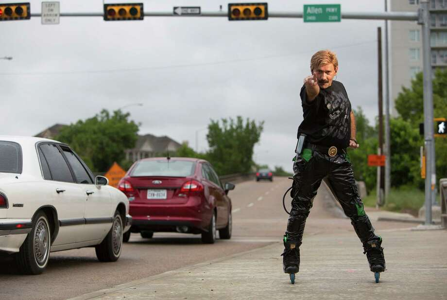 Juan Carlos Restrepo has been dancing on in-line skates at the corner of Montrose and Allen Parkway during rush hour for the past 15 years. Photo: Johnny Hanson, Staff / © 2014  Houston Chronicle