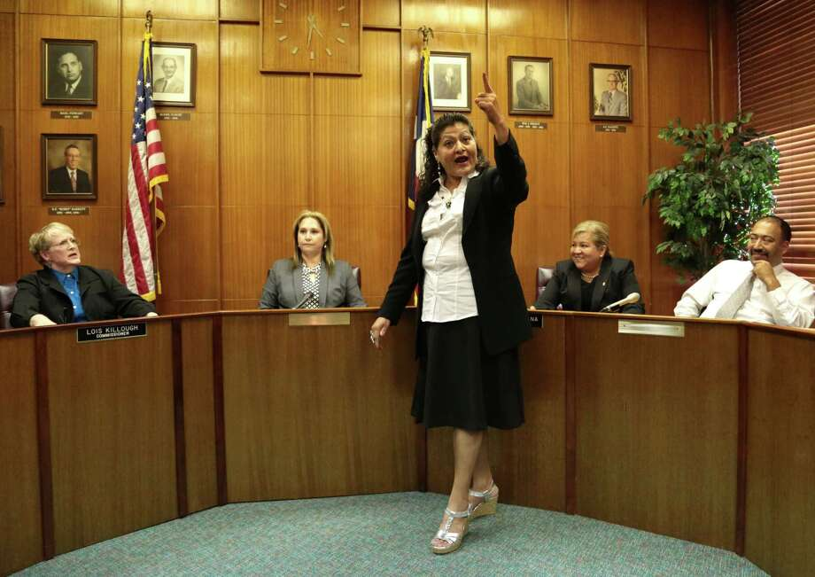 Moya yields the floor to (center) Santos Alvarez a citizen of Galena Park during an open city meeting Monday July 7, 2014 at Galena Park City Hall.  Photo: Billy Smith II, Chronicle / © 2014 Houston Chronicle