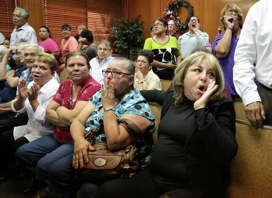 Rosario Flores, right, jeers Galena Park commissioners for leaving the meeting. Photo: Billy Smith II, Chronicle / © 2014 Houston Chronicle