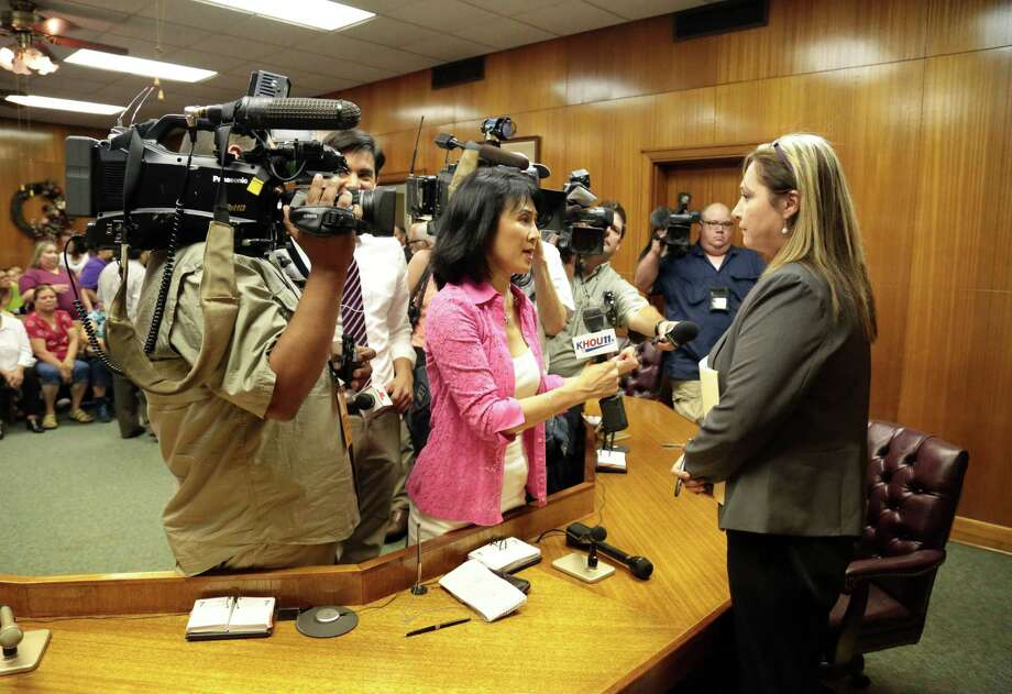 Moya stands alone after talking to the media after the commissioners left the meeting Monday July 7, 2014. Photo: Billy Smith II, Chronicle / © 2014 Houston Chronicle