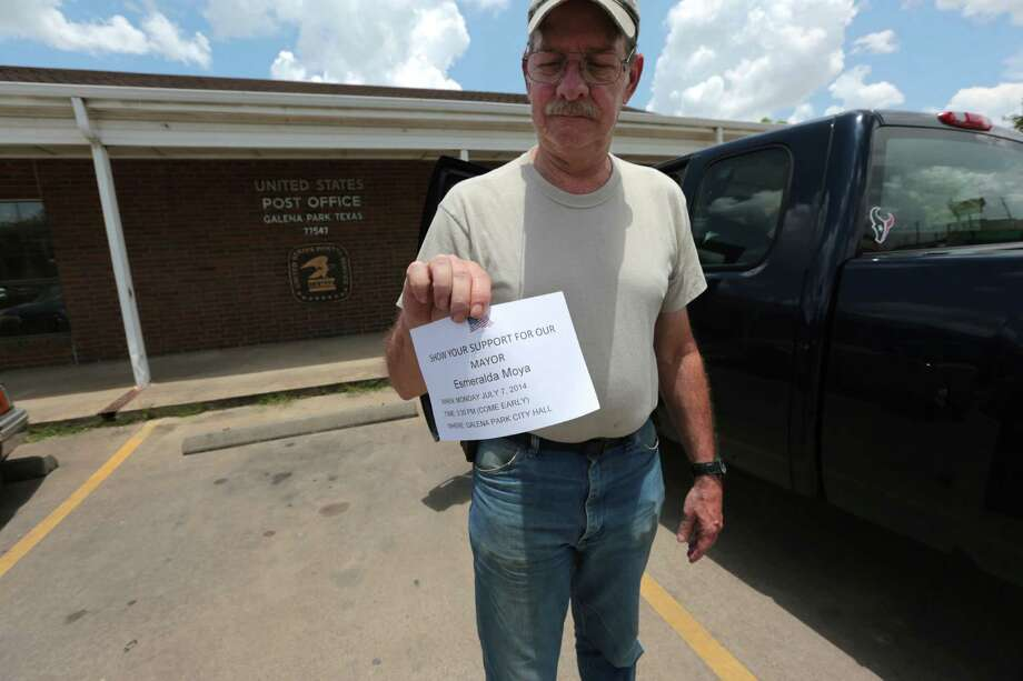 James Mullinax, 60, holds up a flier he found on his door asking for supporters of Moya to show up for a council meeting at Galena Park City Hall  Monday July 7, 2014.  Photo: Billy Smith II, Chronicle / © 2014 Houston Chronicle