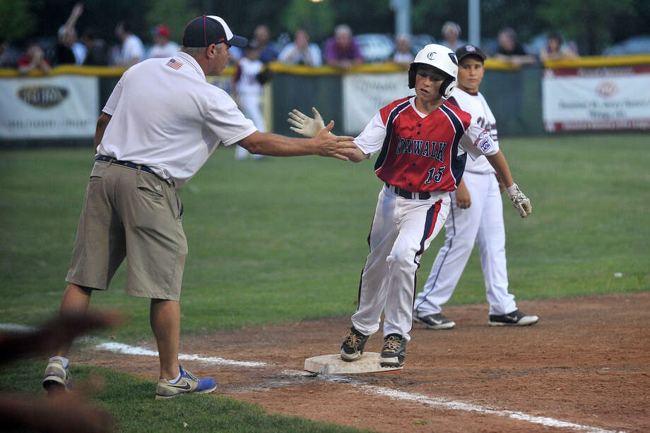 Norwalk's Jake Deleo rounds third base after hitting a home run during Norwalk's Little League Division 1 semifinal game against Stamford National at Scalzi Park in Stamford, Conn., on Monday, July 7, 2014. Photo: Jason Rearick / Stamford Advocate