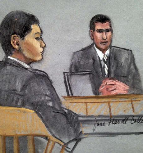 Defendant Azamat Tazhayakov (left)  listens to testimony by an FBI agent. Photo: Jane Flavell Collins / Associated Press / Jane Flavell Collins