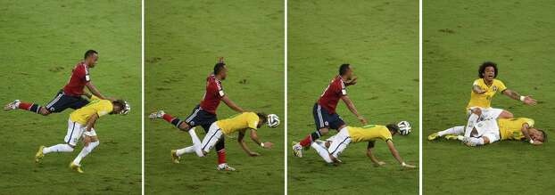 Combination of pictures showing Colombia's defender Juan Camilo Zuniga (L) challenging Brazil's forward Neymar (down) and Brazilian defender Marcelo (R) shouting for help during the quarter-final football match between Brazil and Colombia at the Castelao Stadium in Fortaleza during the 2014 FIFA World Cup on July 4, 2014. Brazil star Neymar was ruled out of the World Cup after that with a back injury, team doctor Rodrigo Lasmar said. Lasmar told reporters Neymar suffered a fracture in the third verterbra of his back during Brazil's bruising 2-1 quarter-final victory over Colombia.  AFP PHOTO / ODD ANDERSENODD ANDERSEN/AFP/Getty Images Photo: ODD ANDERSEN, AFP/Getty Images / AFP