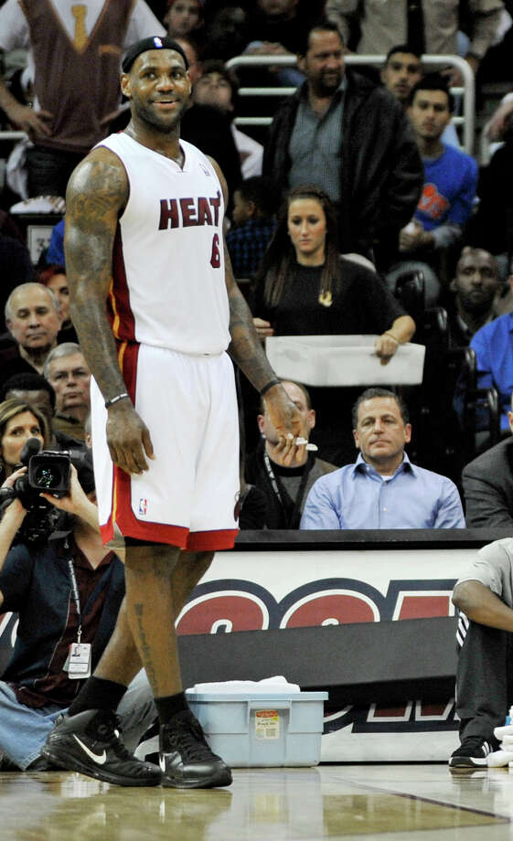 FILE- In this Dec. 2, 2010 file photo, Miami Heat forward LeBron James smiles as Cleveland Cavaliers owner Dan Gilbert, right, watches in the second quarter in an NBA basketball game in Cleveland. As Cavaliers fans breathlessly await a homecoming they never thought possible, the broken relationship between James and Gilbert could get in the way.  (AP Photo/David Richard, File) ORG XMIT: NY160 Photo: David Richard / FR25496 AP