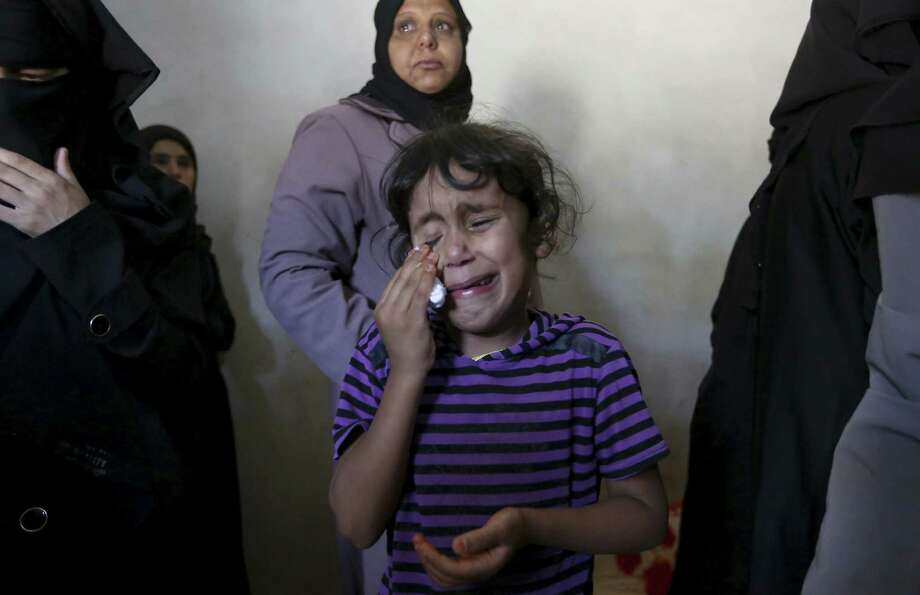 A girl named Asma cries at the funeral of her brother, Gomha Abu Shalouf, 27, a member of the military wing of Hamas who was killed in an airstrike in Rafah in the Gaza Strip. Photo: Hatem Moussa / Associated Press / AP