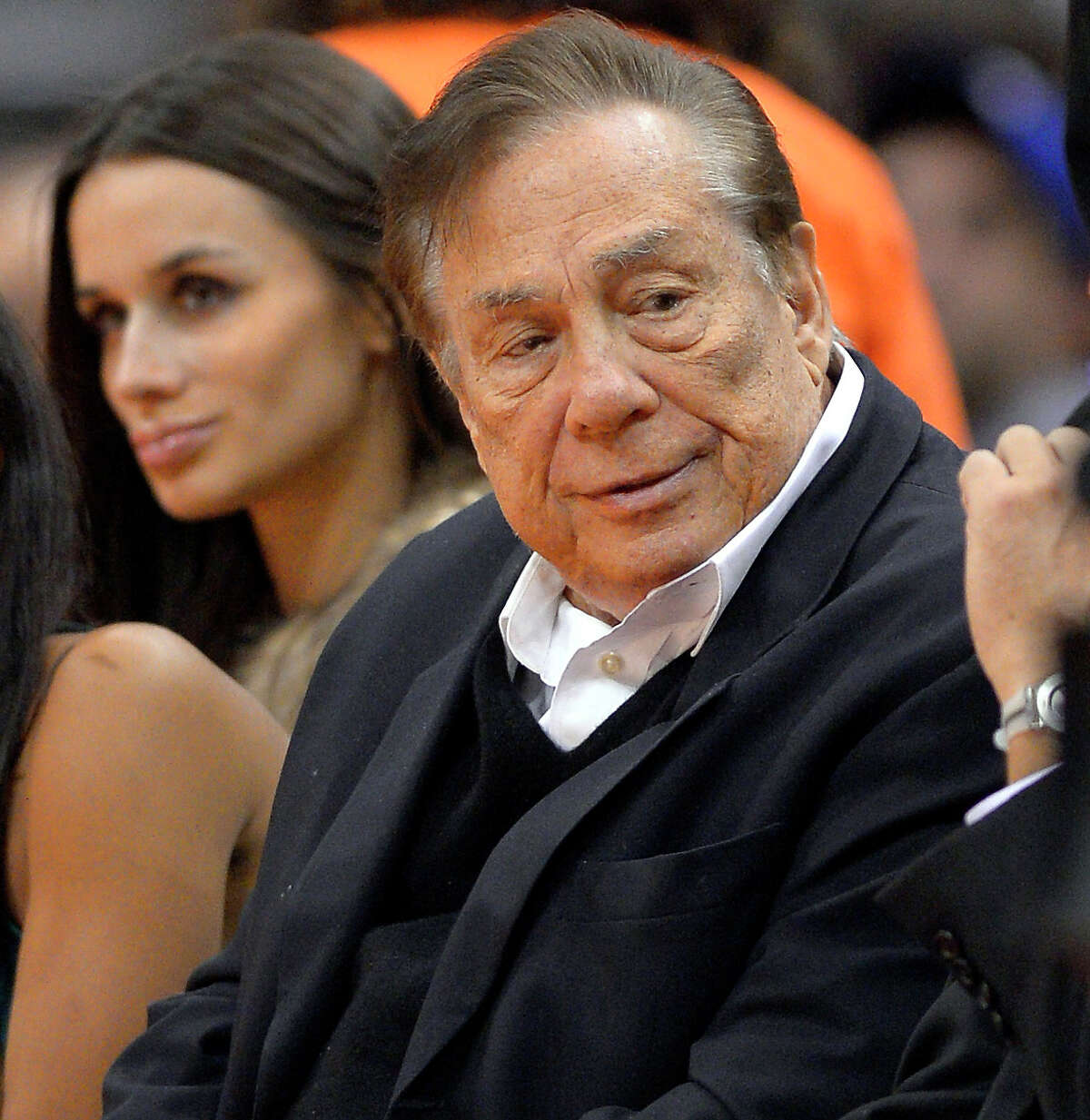 FILE - In this Oct. 25, 2013, file photo, Los Angeles Clippers owner Donald Sterling attends a Clippers game against the Sacramento Kings in Los Angeles. With the potentially record-breaking $2 billion sale of the Los Angeles Clippers hanging in the balance, a trial beginning Monday, July 7, 2014 will focus on whether Donald Sterling's estranged wife had the authority under terms of a family trust to unilaterally negotiate the deal. (AP Photo/Mark J. Terrill, File) ORG XMIT: NY157