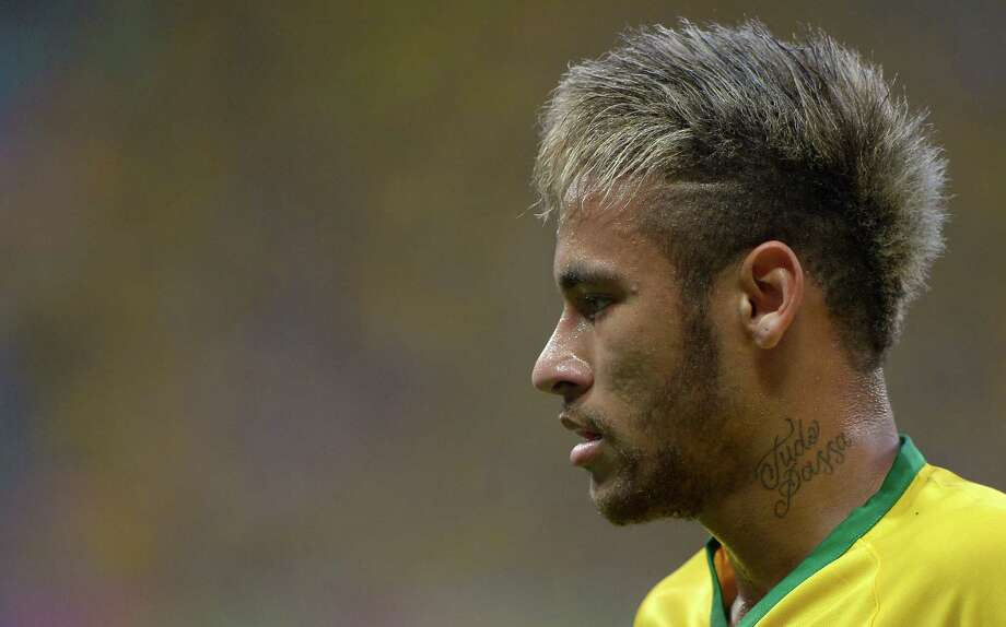 Brazil's Neymar pauses during the World Cup quarterfinal soccer match between Brazil and Colombia at the Arena Castelao in Fortaleza, Brazil, Friday, July 4, 2014. (AP Photo/Manu Fernandez) ORG XMIT: WCTH271 Photo: Manu Fernandez / AP