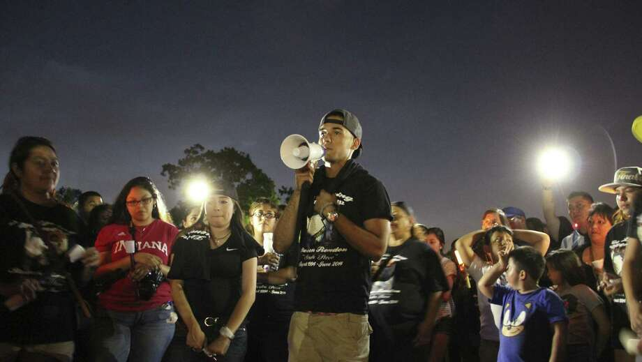 Matthew Tellez, 19, tells a story about Steven Rendon at a candlelight vigil Sunday night at Harlandale Memorial Stadium. Rendon was found dead June 30. Tellez and Rendon had played drums together in the school band since sixth grade. Photo: Photos By Jolene Almendarez / San Antonio Express-News / San Antonio Express-News