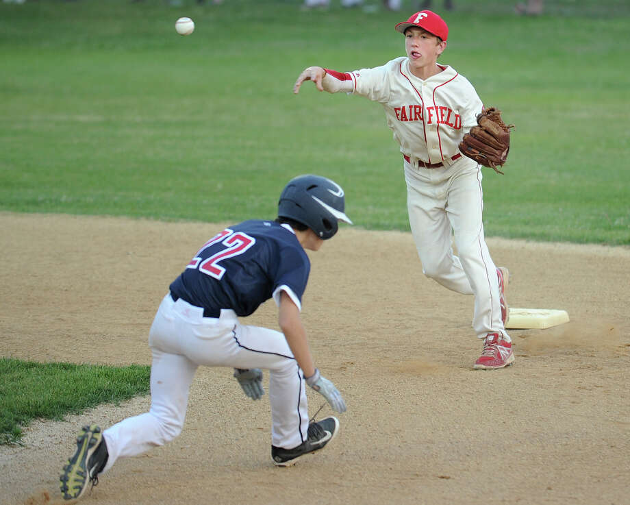 Fairfield American's Brian Howell turns a double play over Westport's Kevin Rabacs in the 1st inning of their opening game in the Little League District 2 double elimination tournament at Unity Park in Trumbull, Conn. on Monday, July 7, 2014. Photo: Brian A. Pounds / Connecticut Post