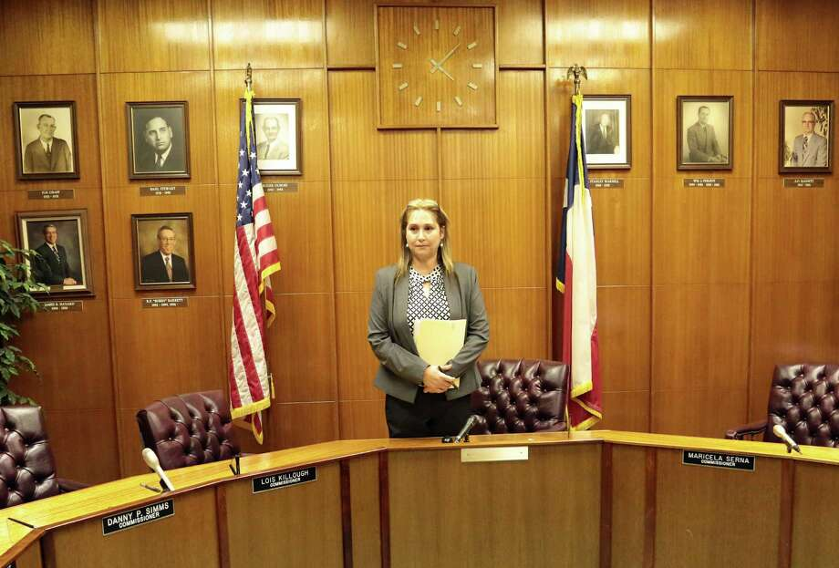 Galena Park Mayor Esmeralda Moya stands alone after the City Council meeting Monday night that reversed her decisions. Photo: Billy Smith II, Staff / © 2014 Houston Chronicle