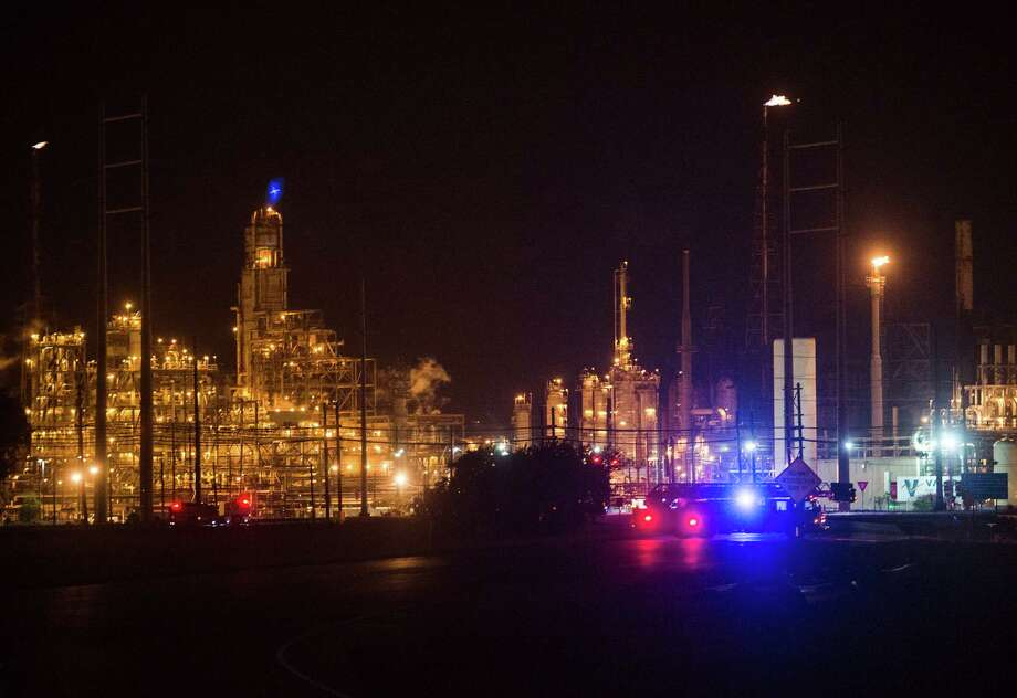 Emergency vehicles sit outside the Chevron Phillips plant in Port Arthur on Monday night. A fire occurred at the Chevron Phillips plant in Port Arthur Monday night. Photo: Jake Daniels/@JakeD_in_SETX / ©2014 The Beaumont Enterprise/Jake Daniels
