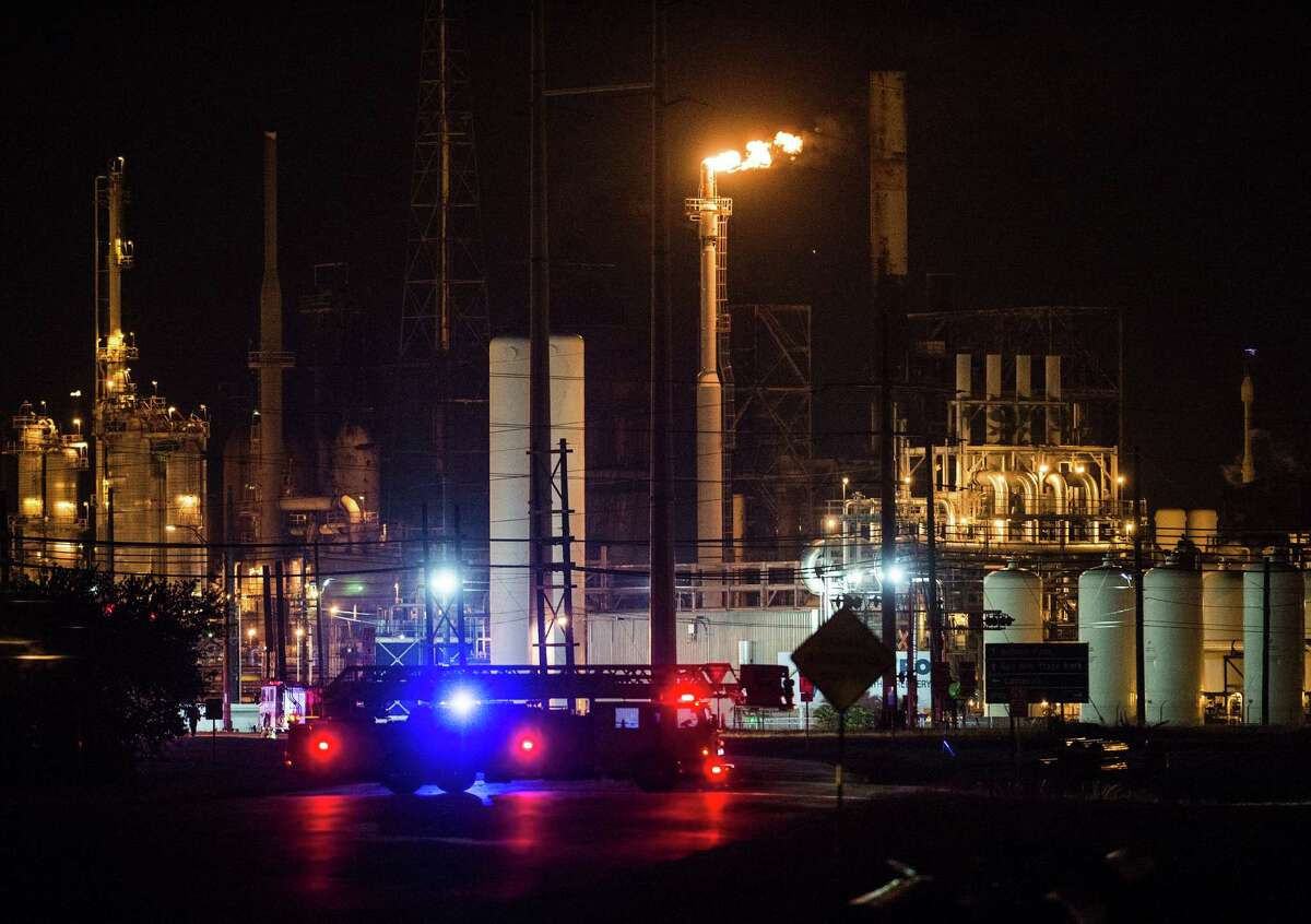 Emergency vehicles sit outside the Chevron Phillips plant in Port Arthur on Monday night. A fire occurred at the Chevron Phillips plant in Port Arthur Monday night. Photo taken Monday 7/7/14 Jake Daniels/@JakeD_in_SETX