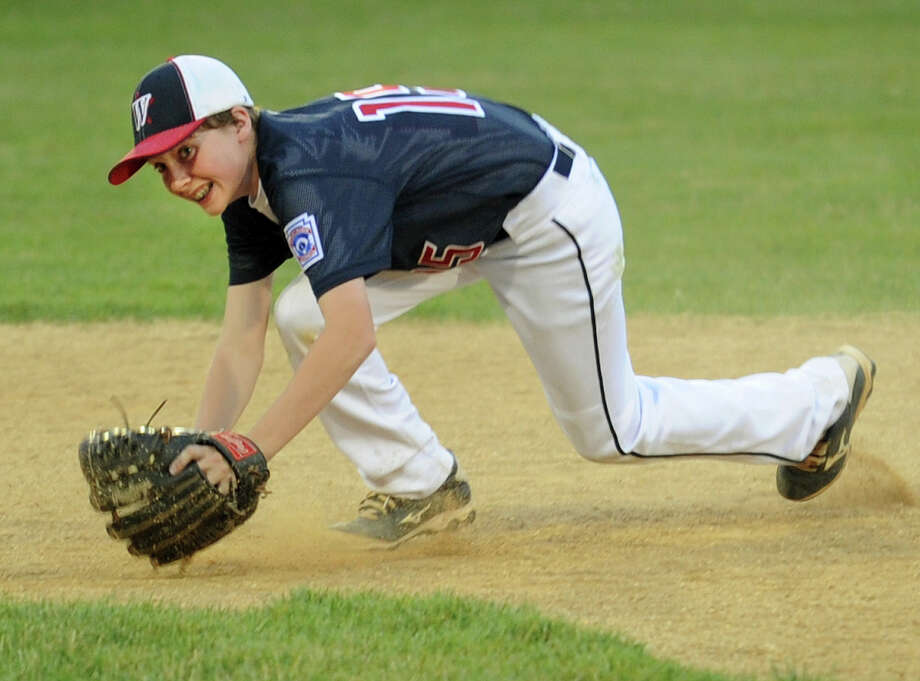 Westport's Will Eichhorn makes a play on a ground ball during the 3rd inning of his team's opening game with Fairfield American in the Little League District 2 double elimination tournament at Unity Park in Trumbull, Conn. on Monday, July 7, 2014. Photo: Brian A. Pounds / Connecticut Post