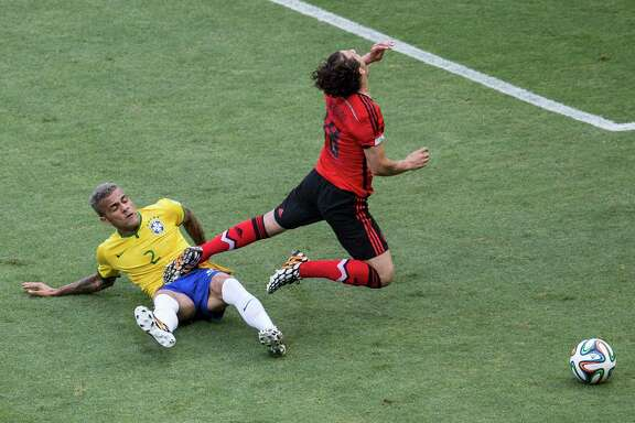 "Brazil's reputation for playing the ""beautiful game"" is taking a beating as rough plays like Dani Alves' tackle of Mexico's Andres Guardado, right, have become too common, according to German coach Joachim Loew."