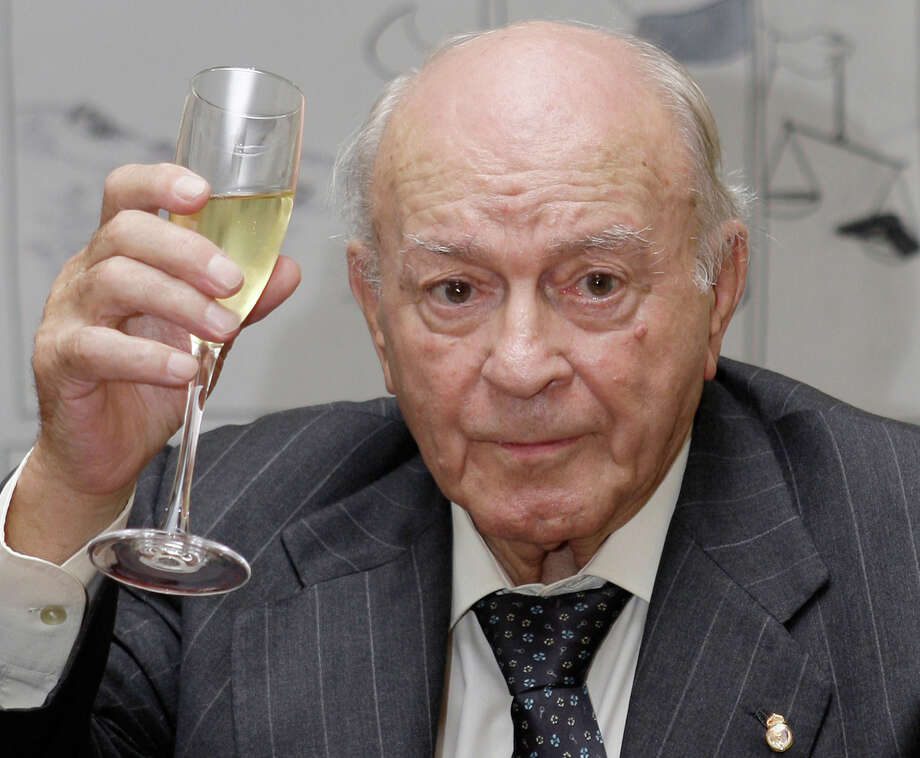 FILE - In this Nov. 13, 2009 file photo, former Real Madrid soccer star and the club's honorary president, Alfredo Di Stefano of Argentina raises his glass during a tribute to his contribution to sport at the Argentine Embassy in Madrid, Spain. Real Madrid on Monday July 7, 2014 says Alfredo Di Stefano has died at age 88. Di Stefano helped Madrid win five straight European Champions Cups, and was voted European player of the year in 1957 and '59. (AP Photo/Paul White, File) Photo: Paul White, STF / AP