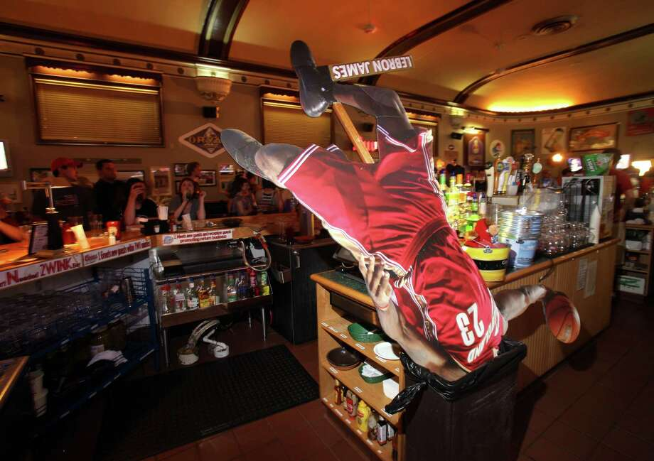 What a difference four years can make. A cutout of LeBron James at a Cleveland restaurant was unceremoniously trashed in 2010 when he chose to join the Heat, but news of his possible return to the city is now being greeted with enthusiasm. Photo: John Kuntz, MBO / The Plain Dealer