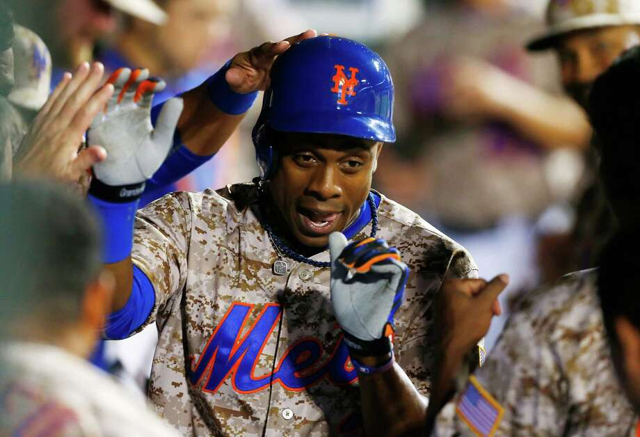 NEW YORK, NY - JULY 07:  Curtis Granderson #3 of the New York Mets celebrates his eighth-inning home run against the Atlanta Braves at Citi Field on July 7, 2014 in the Flushing neighborhood of the Queens borough of New York City.  (Photo by Jim McIsaac/Getty Images) ORG XMIT: 477586125 Photo: Jim McIsaac / 2014 Getty Images