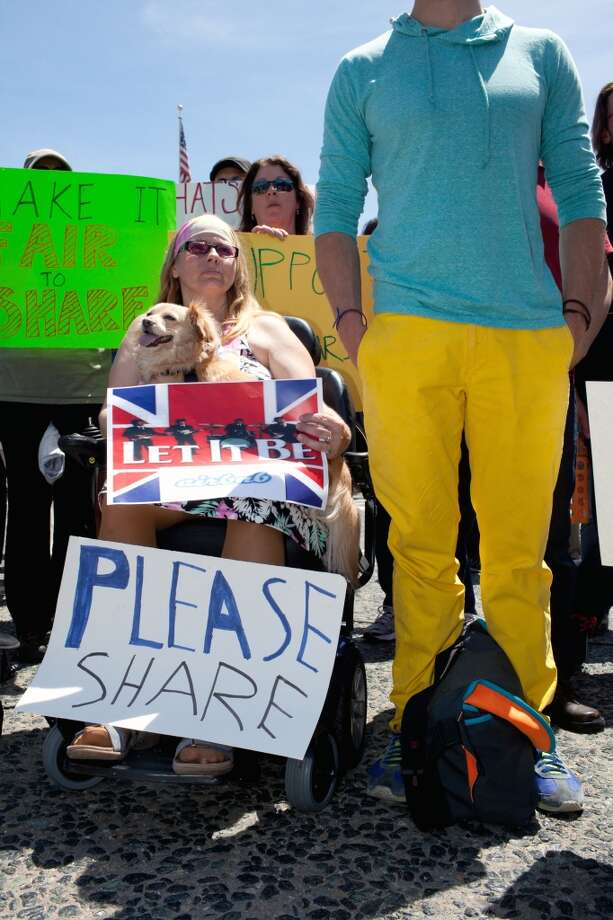 Victoria S attends a house share rally with her dog Princess at the Civic Center Plaza in San Francisco, Calif. on Tuesday, April 29, 2014. Supporters came out to discuss a ballot initiative that would limit short-term rentals in San Francisco. Victoria, who would not give her last name, hopes to use Airbnb to eventually get off social security. Photo: Special To The Chronicle