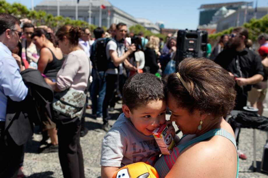 Leah Pimentel holds her son, Lawrence, 2, at a house share rally at the Civic Center Plaza in San Francisco, Calif. on Tuesday, April 29, 2014. Supporters came out to discuss a ballot initiative that would limit short-term rentals in San Francisco. Photo: Special To The Chronicle