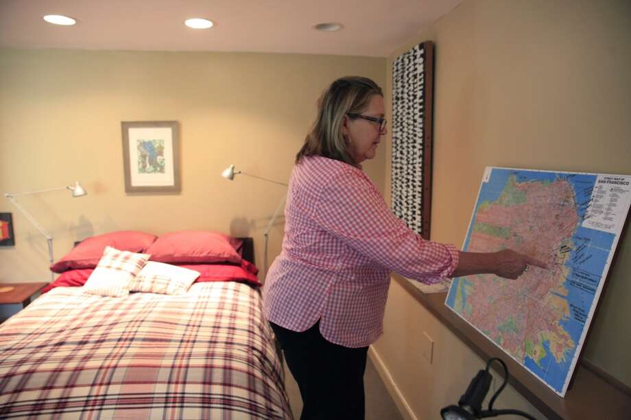 AirBnb host Kepa Askenasy looks over a San Francisco map on Wednesday May 28, 2014  in San Francisco, Calif. Askenasy has included a map in guests rooms to help them navigate the city. Photo: The Chronicle