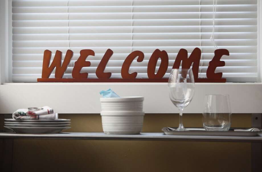 A welcome sign and kitchenware is seen in a room rented by AirBnb host Kepa Askenasy  on Wednesday May 28, 2014  in San Francisco, Calif. Photo: The Chronicle