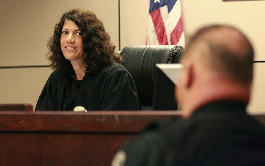 Judge Lorina Rummel (left), who won a Republican primary runoff in May, speaks with the bailiff on her first day in the 144th state District Court. Photo: John Davenport / San Antonio Express-News / ©San Antonio Express-News/John Davenport