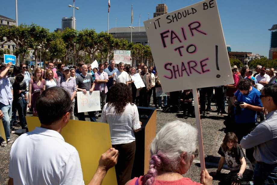 House share supporters attend a rally at the Civic Center Plaza in San Francisco, Calif. on Tuesday, April 29, 2014. Supporters came out to discuss a ballot initiative that would limit short-term rentals in San Francisco. Photo: Special To The Chronicle