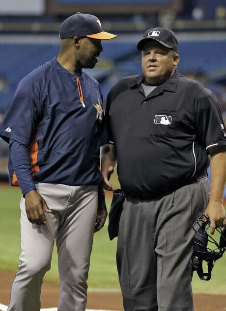 Umpire Fieldin Culbreth, talking to Astros manager Bo Porter during a game last month, says he doesn't understand the science of the study and makes calls from his head and heart. Photo: Chris O'Meara, Associated Press / AP