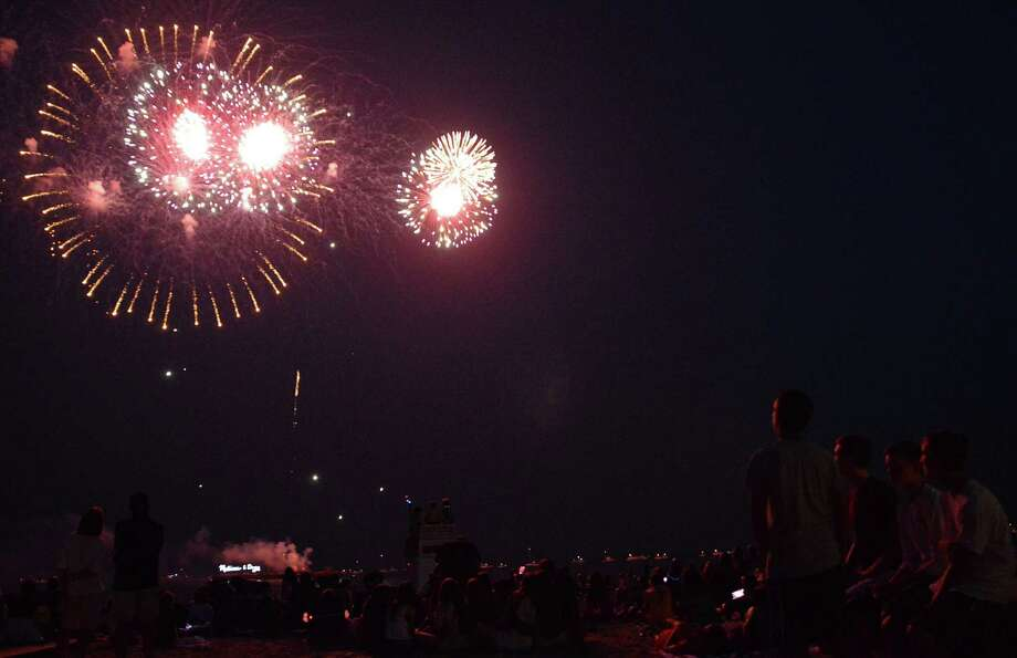 Bombs bursting in air Monday night over Compo Beach drew a crowd of thousands for the annual Indpendence Day fireworks show. Photo: Jarret Liotta / Westport News