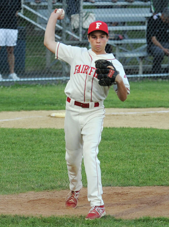 PJ Egan, Fairfield American's pitcher, throws to first base to get the out against Westport on Monday, July 7 in a Little League District 2 tournament game at Unity Park in Trumbull. Egan slugged a home run in Fairfield's 8-3 victory in the double-elimination tournament. Photo: Brian A. Pounds / Connecticut Post