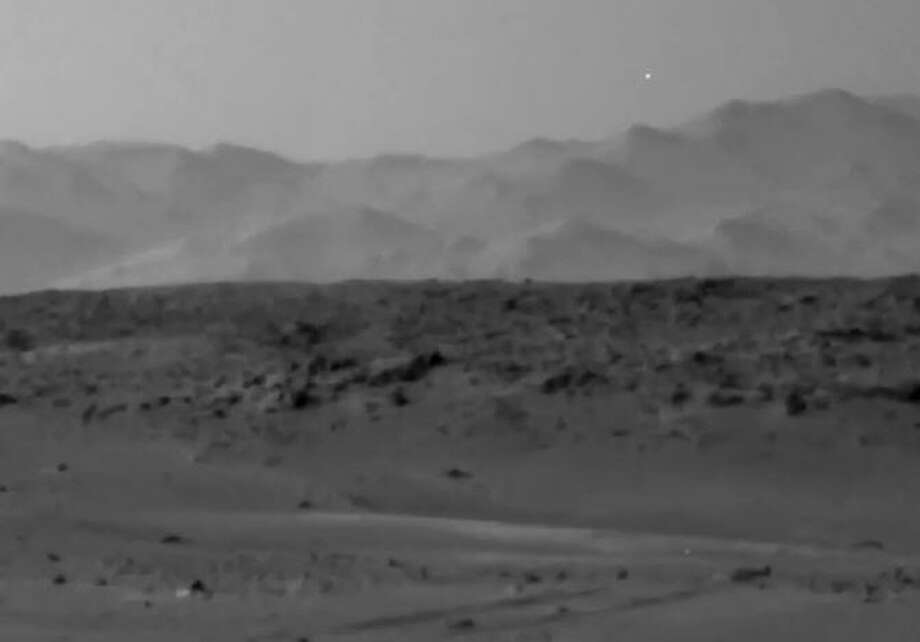 UFO Light on Mars?The light can be seen in the upper right corner of the frame, above a line of Martian hills.The light isn't the first mysterious item spotted by the Mars rover. Here's what else space spotters have seen... Photo: NASA Rover Image