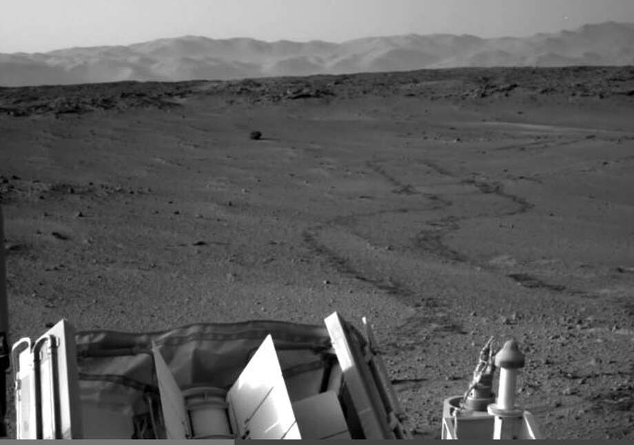"Light from a UFO on Mars?YouTube user ""UFOs and SpacE"" claims this photo shows a light from a UFO landing on the surface of Mars. the image was captured by the Mars Rover in 2014. Check out the next slide for a zoomed in shot and decide for yourself. Photo: NASA Rover Image"