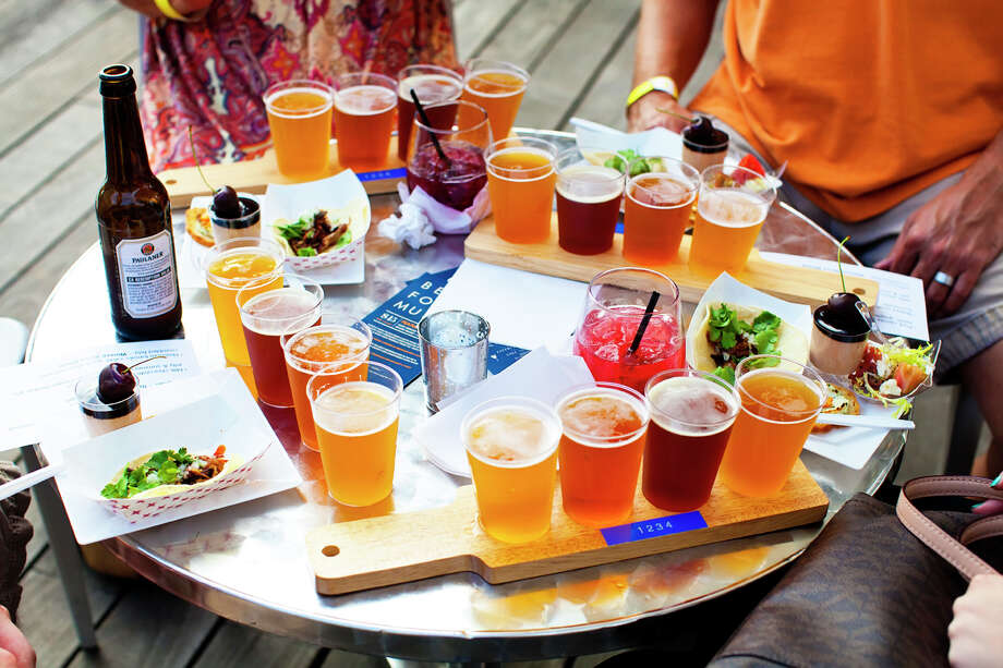 Discovery Green and The Grove restaurant are teaming to launch their yearly Sundown at The Grove series that offers craft beer tastings paired with food from the restaurant. Photo: Discovery Green / Discovery Green