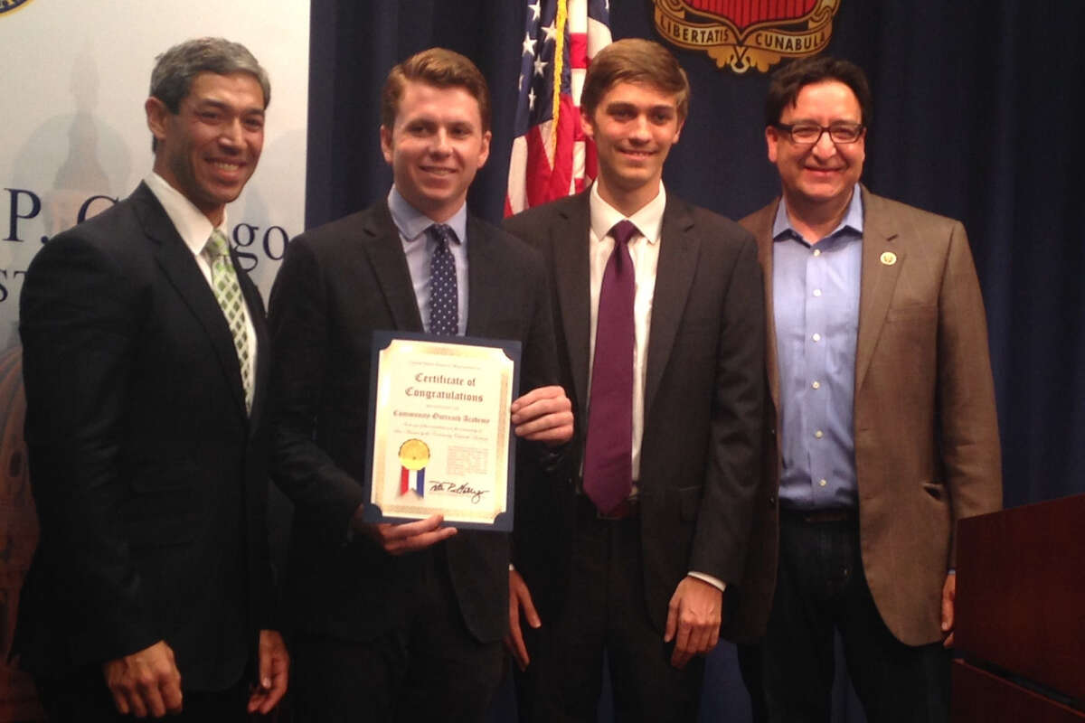 San Antonio City Councilman Ron Nirenberg, from left, District 8 Community Academy director Noah Howe, the academy's former co-director Chris Stewart and U.S. Rep. Pete Gallego, D-Alpine, celebrate the Congressional Recognition Award that the congressman bestowed on the academy that Nirenberg's office operates.