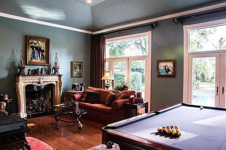 1380 Audubon Pl, Beaumont: $1,125,000The family room has a gas fireplace and space for a pool table. Photo: Zillow