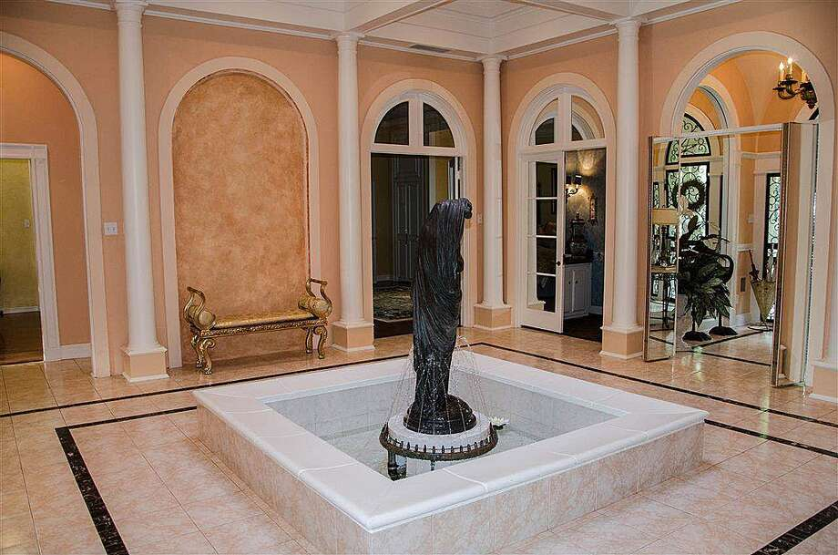 1380 Audubon Pl, Beaumont: $1,125,000An interior fountain with bronze statue sits in the middle of the entryway. Photo: Zillow