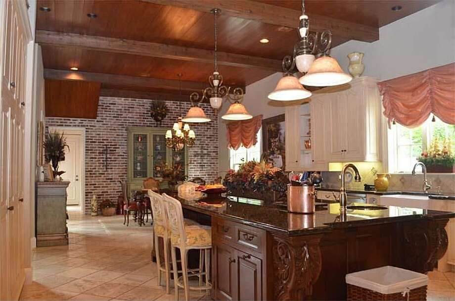1355 Thomas Rd, Beaumont: $2,450,000The large kitchen has an island work center, custom Osborn cabinets, a sub-zero refrigerator/freezer and Viking appliances. Photo: Zillow