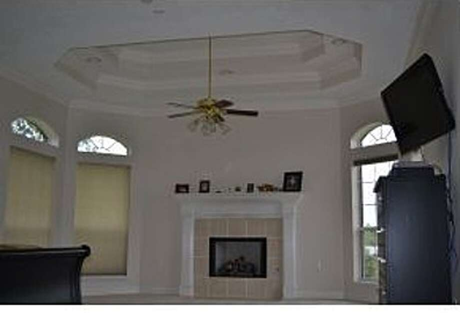 195 Bower Dr, Bridge City: $1,275,000The living room offers high ceilings and a fireplace. Photo: Zillow