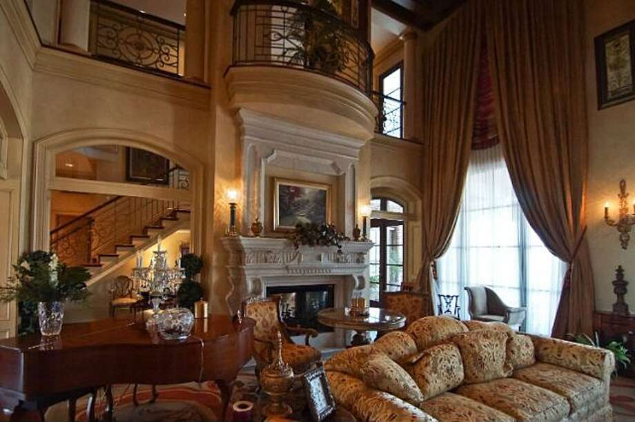 6 Estates Of Montclaire, Beaumont: $3,250,000The elegant and spacious living room has a fireplace and vaulted ceilings. Photo: Zillow