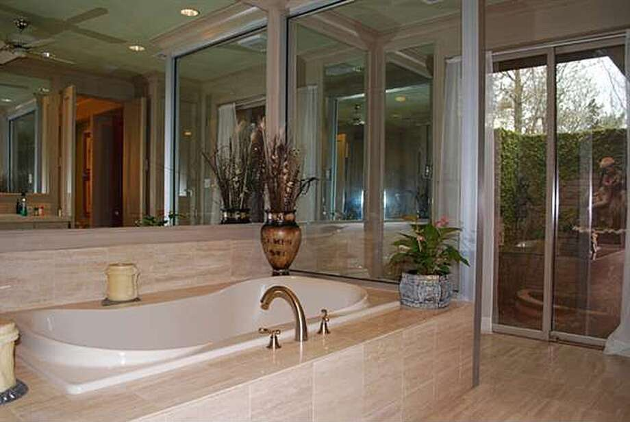 3 Oaktrace St, Beaumont: $1,550,000The master bathroom has a spa bath. Photo: Zillow