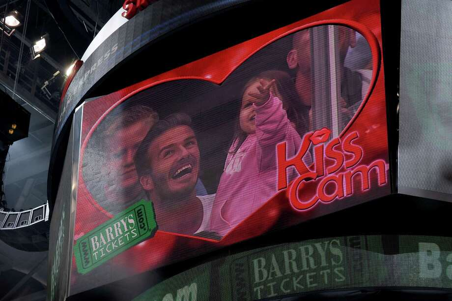 9) When the Kiss Cam is framing you and your significant other don't be a bad sport and refuse a kiss. In that same line of thought don't take the person you are having an affair with because the Kiss Cam will find you.  Photo: Andrew D. Bernstein, Getty / 2013 NHLI