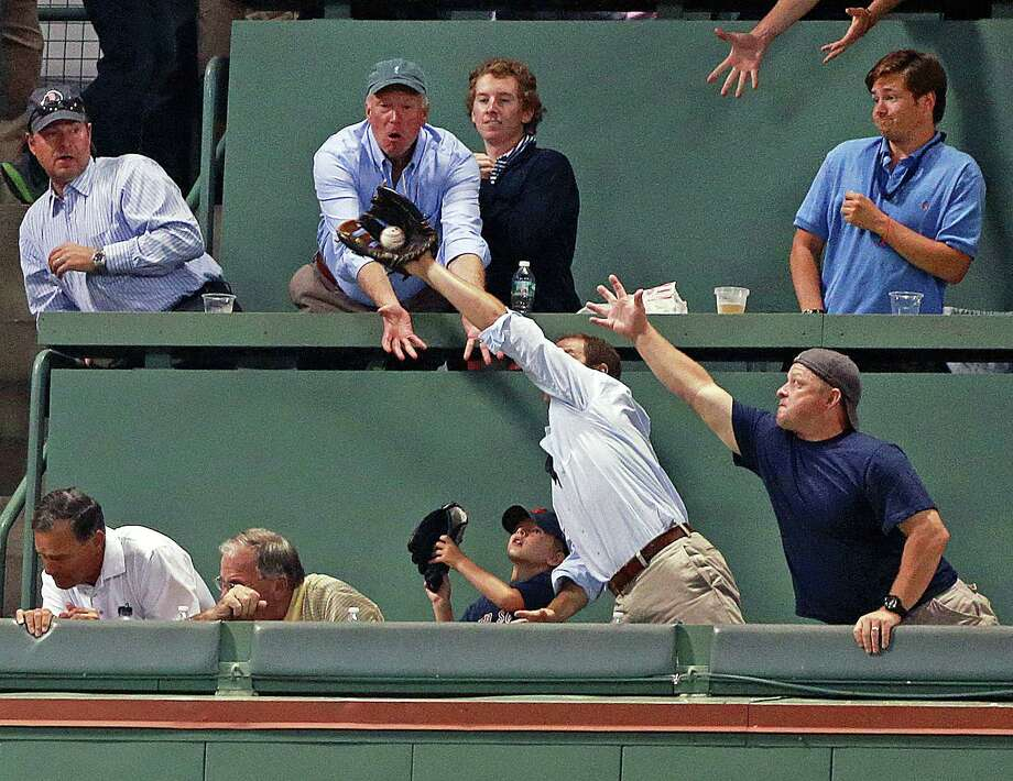 6) If you are over 18 there is no need for you to bring a glove to the game. Your only excuse is if you have a kid under the age of 10 and you are helping them catch a fly ball, or if you are going to give every ball you catch to a nearby kid. Otherwise let the children have the fun. Photo: Boston Globe, Getty / 2013 - The Boston Globe - The Boston Globe