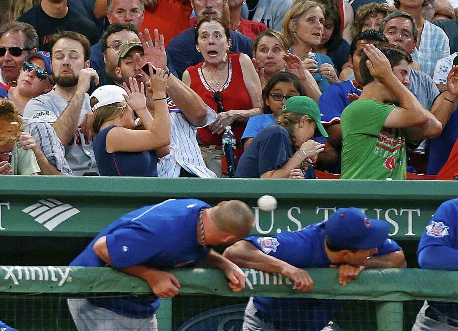 1) Don't trust other people to tell you when a fly ball is heading your way like a heat-seeking missile, and should the missile lock on your area, don't use your girlfriend as a human shield.  Photo: Boston Globe, Getty / 2014 - The Boston Globe